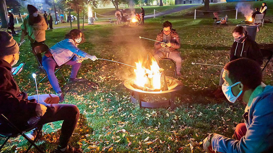 Students around a campfire at night